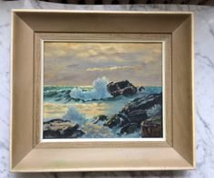 Lovely rough seas original vintage oil painting in vintage frame. Likely a student painting. Canvas board has a stamp from Currys Art store, a toronto store that dates back to 1911. Not sure of age but I am guessing 50s.  Lightweight wood frame Measures 17 x 15 x 2 deep. Canvas board measures 10 x 12.  Some minor staining to frame in one spot and has a general vintage patina, please see photos. There are also two marks on waves, see last photo, could probably be cleaned off but I leave that…