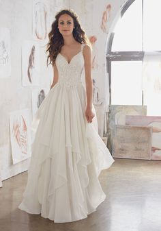 This Boho Lace 2017 Wedding Gown Beautifully Combines Romantic Layers of Flounced Chiffon and a Fitted Bodice Adorned with Venice Lace AppliquŽés.