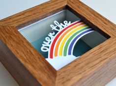 This cute and colourful miniature 'Over The Rainbow' paper cut, is designed and cut by Paper Petal. Encased in a deep dark oak box frame, Price £28