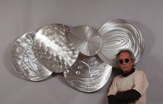 """""""Heat of Shadows""""  33"""" x 60"""" x 12""""  welded, polished, brushed aluminum wall sculpture.  ©Mac Worthington, artist  For further information on this piece or to discuss a custom design please call 614-582-6788 or email: macwartist@aol.com"""