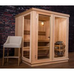 Almost Heaven Grayson 4-person Indoor Steam Sauna Constructed with Canadian hemlock and fir with red cedar benches. 6kW stainless steel heater, hardware, tempered full glass door.