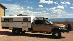 Dodge 5500 flatbed camper.needs to be a little lower on the chassis, be removable and have atv storage on top.