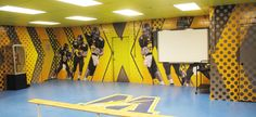 """Wellston High School Football Locker Room Wall Mural. This football locker room wall mural was produced and installed by GameDay Vision and appeared on ESPN's """"Rise Up""""."""