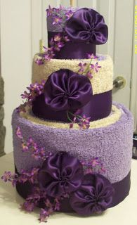 Towel cake idea.  Great wedding shower gift.  I have made them before but never quite like this!