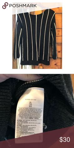 "Banana Republic oversized stripe sweater So cozy!! This is a dark grey and white stripe ( grey is hard to see in photo). This is a XL, and it's oversized on me but not that big at all! I wouldn't have bought any other sized because it ran EXTREMELY small ( I am 5'2"" & 110 pounds). Perfect condition. I would wash on delicate & hang to dry Banana Republic Sweaters Crew & Scoop Necks"