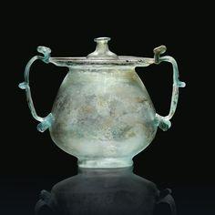A RARE GALLO-ROMAN BLUE-GREEN BLOWN GLASS LIDDED URN OR CINERARIUM 1ST-2ND CENTURY A.D.