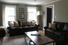 Lighter color scheme with black leather couches