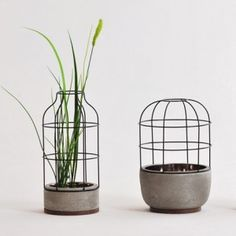 """hilarious! it looks like weeds growing up through junk. Except for awesomely. A grassy plant is definitely the way to go. These container appear to be modified upcycles of old lightbulb safety cages. The often come with a glass insert (hences the nicknames """"jelly jars"""") you could invert--TADA!---terrariums. V4 vases by Seung-Yong Song"""