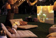 Rustic Home Theater with Basket lamp shades, Movie screen, Pendant light, High ceiling, String lights, Outdoor home theater