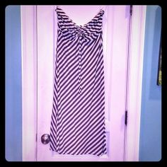 SALE! bebe Strapless Black & White Striped Dress M Beautiful long black & white striped dress from bebe. Size medium & approximately 37 inches long x 15 inches wide. Drawstring in the middle to adjust for different size chests and an elastic band at top to keep it on.  About knee length. Perfect for summer! Can be dressed up or down.  Please let me know any questions. Reasonable offers will be considered. Thanks for visiting! bebe Dresses Strapless