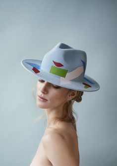 Inspired by the colors of bright Mexican doorways and Henri Matisse, British milliner Laura Apsit Livens has designed a most playful and colorful collection of cloches, berets, trilbys and boaters for fall - and quite honestly, it's her best collection yet. The London College of Fashion alumna