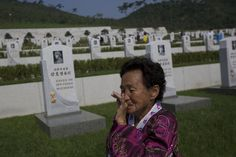 North Korean Kang Ok Ran, 72, weeps near the grave of her Korean War veteran father, Kang Ho Yong who died in 1951, at a cemetery for Korean War veterans on Thursday, July 25, 2013 in Pyongyang, North Korea marking the 60th anniversary of the signing of the armistice that ended hostilities on the Korean peninsula. (AP Photo/David Guttenfelder)