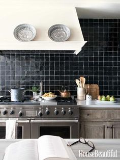 Black  tile backsplash + washed out wood