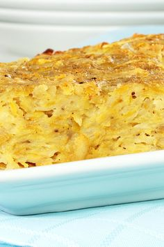 Recipe including course(s): Side; and ingredients: black pepper, egg, onions, potatoes, salt, vegetable oil