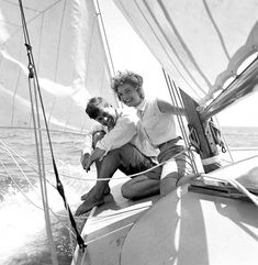 John F. Kennedy and then-fiancé Jacqueline Bouvier sailing the 'Victura' off the coast of Hyannis Port, Massachusetts in crisp whites