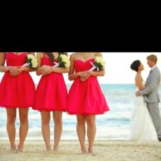 LOVE this picture of the bride and groom and bridesmaids & the hot pink short bridesmaids dresses!