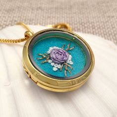Beautiful! This is a one of a kind hand embroidered locket, it would be a great gift for teens, moms, grandmas, teachers and friends. Floral Rose embroidery pendant necklace.   https://www.etsy.com/listing/252833023/embroidered-necklace-embroidery-jewelry