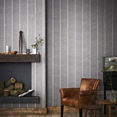 A sophisticated horizontal charcoal texture wallpaper, juxtaposed with a vertical linear emboss to create a fabric effect. The grey stripe is finished with a beautiful silver embellishment and will add definition to your home.