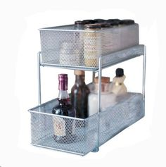 Design Ideas Cabinet Baskets Mesh Silver by Design Ideas. $32.00. From the original makers of mesh. 2 tier organizer cleans up cabinet clutter. Slide the basket out to easily access sauces and spices. Design Ideas Cabinet Baskets-Mesh-Silver