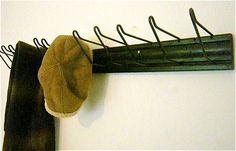 Vintage Industrial Coat Rack / Hat Rack / Display Rack. $46.00, via Etsy.