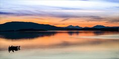 Sunset behind the Isle of Jura, Scotland,   http://picture-gallery.alexsaundersphotography.co.uk/  http://alex-saunders.artistwebsites.com/index.html  and http://photo4me.com/canvasprints/Alex-Saunders #sea #water #coast #reflection #photography #outdoors