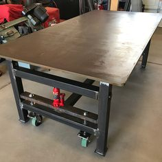 "Throwback to the 1000 lb + table build in 2017. 3/4"" top, adjustable feet and jacks to raise around and move with the push of a finger. #workbench"