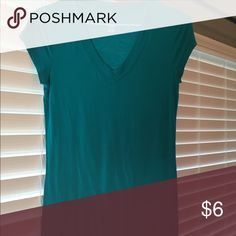 """v-neck top Longer length, stretchy fabric. It is truly more teal than blue. 18"""" pit to pit, 26"""" length. Tops Tees - Short Sleeve"""