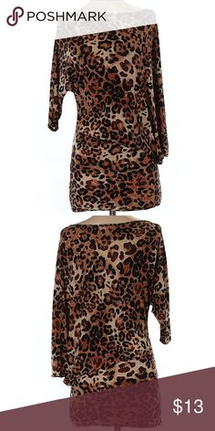 """Avital 3/4 Sleeve Black Brown Animal Print Top Avital 3/4 Sleeve Black and Brown Animal Print Top. Women's Size Small. Boat Neckline. Measurements 34"""" Chest 34"""" Length. 92% Polyester 8% Spandex. Gently used condition. Avital Tops Blouses"""