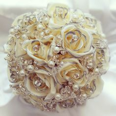 I like the idea of pearls and crystals together for a vintage bouquet, just not SO much. And the ugly silk silver-edged roses are toooo much.