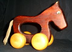 Hey, I found this really awesome Etsy listing at https://www.etsy.com/listing/199391135/vintage-wooden-horse-toy-with-wheels