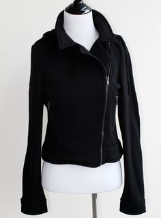 """This jacket goes with everything - from dresses to jeans. Features a detachable hood and asymmetrical """"biker"""" jacket look. Pair with a plaid skirt and platform boots. Distinguishing features: Detachab"""