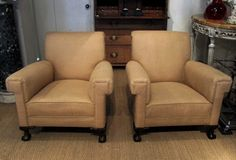 a-large-pair-of-english-armchairs