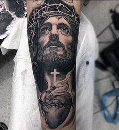 Top 101 Jesus Tattoo Ideas - Inspiration Guide] - Man With Tattoo Of Jesus Holding Cross And Heart Forearm Sleeve - Jesus Forearm Tattoo, Jesus Tattoo Sleeve, Forearm Tattoos, Sleeve Tattoos, Jesus Tatoo, Jesus On Cross Tattoo, God Tattoos, Body Art Tattoos, Mens Tattoos