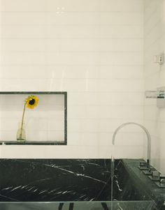 Apartement Sun Flower Displayed Near Home Bathroom Built Under Shelving Next To Black Marble Tub Interior Color Theme in Loft Interior for Creative Mind