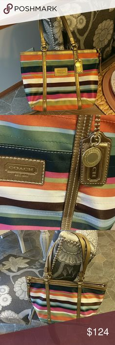 Authentic Coach Legacy Stripe Bag Good used condition. Normal used wear on corners, pics reflect. A couple of small spots on interior of bag, as pic reflects and price. This has been one of my favorite bags! It's in good used condition. It's hard for me to part with this beautiful bag, but it's time for a new one for me! 14x10, it's a nice size bag. Bronze leather. Straps are in great shape. Any questions, feel free to ask. Smoke free home. Gorgeous bag! Coach Bags