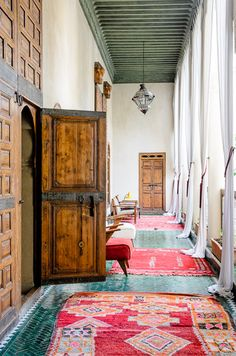 colourful rugs in Marrakech, wood doors