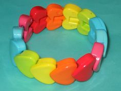 How cool were these? Vintage MOD 80s Rainbow Heart Plastic Stretch Bracelet. $10.00, via Etsy.