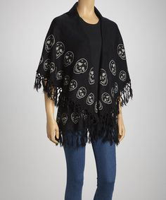 On days that call for a piece with personality, opt for this stylish poncho. A daring print and fringe hem bring unique detail to its draped, casual silhouette.