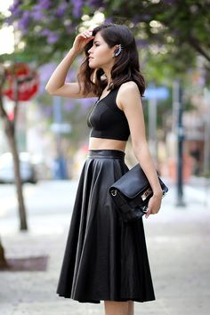 1eee41aa20 Adriana Gastellum is wearing a black zipper crop top from Topshop, black faux  leather midi