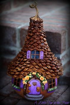 Step by step TUTORIAL for this FAIRY HOUSE - this post starts at the beginning --- large pinecones to use for shingles, dry-brushing on some sienna and metallic gold acrylic paint, polymer clay, water-based brush-on sealer called Diamond Flecto Varathane (Satin),