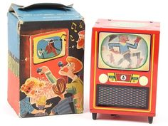 (RARE) JOUSTRA (FRANCE) BABY TELEVISION - tin lithograph wind-up. In action, a scene comes alive on the TV screen along with a buzzer.