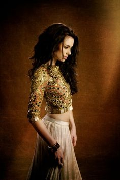 Gold lehenga by Arpita Mehta. Indian South Asian desi fashion.