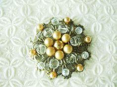 Broche oro y plata.