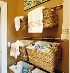 Hanging baskets on the wall creates instant storage for towels, toiletries, toys and other things that are currently cluttering your home.  www.thestillingsgroup.com