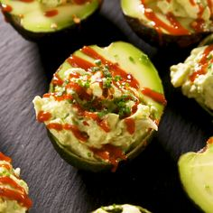 Think of these as egg salad-stuffed avocados with some definite deviled egg vibes. We love them drizzled with hot sauce and sprinkled with sesame seeds and chives. But the sky's the limit. Easy Egg Salad, Avocado Egg Salad, Avocado Boats, Avocado Deviled Eggs, Quinoa Salad, Healthy Appetizers, Appetizer Recipes, Healthy Snacks, Seafood Appetizers