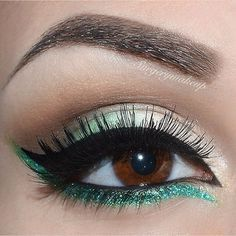 This sparkly green bottom liner really brightens brown eyes.