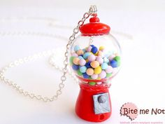-Silver plated long chain necklace!-The old fashioned yet classic gumball machine full of gums!