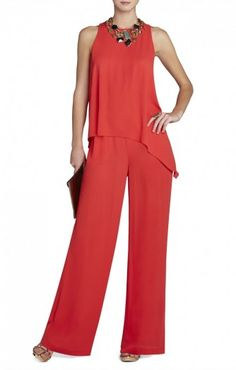 $186.00 Slip into this dramatically draped jumpsuit for an instantly chic and confident look. Round neck. Sleeveless.Draped asymmetrical overlay top. Wide leg.Button-and-loop with snap closure at back neck.Georgette: Polyester.Dry Clean.Imported