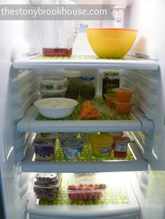 DIY Fridge Mats: This looks so simple and it would make cleaning up spills very easy!