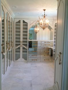 Mirrored drawers and tons of shelves in this walk-in closet